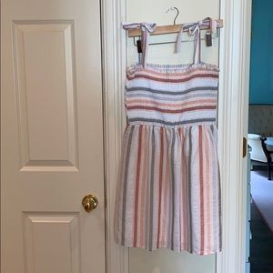 Striped dress with adjustable bow tie straps